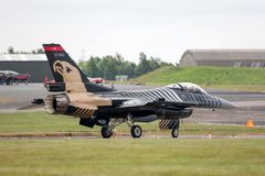 Turkish Air Force General Dynamics F-16CG Fighting Falcon 91-0011 of the `Solo Turk` display team. RAF Waddington, Lincolnshire, UK - July 4, 2014: Turkish Air Royalty Free Stock Images
