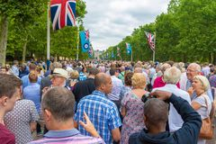 RAF 100 year celebration. The Royal Air Force 100 year celebration in the Mall London near Buckingham palace. Here the crowds of people gathered for the Royalty Free Stock Photos