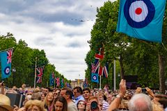 RAF 100 year celebration. The Royal Air Force 100 year celebration in the Mall London near Buckingham palace. Here the crowds of people gathered for the Stock Photos