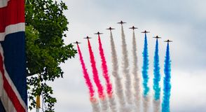 RAF 100 year celebration. The Royal Air Force 100 year celebration in the Mall London near Buckingham palace. Here you can see the Red arrows in formation with Stock Photo