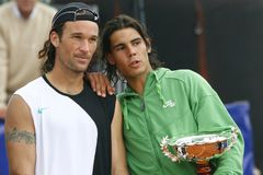 Rafa nadal and carlos moya. Spanish tennis top players Rafa Nadal and Carlos Moya gesture after their tournament game in the island of Mallorca. Moya is actually Stock Photos