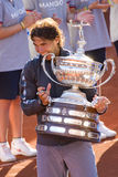 Rafael Nadal with trophy. BARCELONA - APRIL 29: Spanish tennis player Rafael Nadal wins the final match against David Ferrer at Barcelona tennis tournament Conde Royalty Free Stock Image