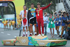 Rafal Majka POL L, Olympic champion Greg Van Avermaet BEL and Jakob Fuglsang DEN during men Cycling Road medal ceremony. RIO DE JANEIRO, BRAZIL - AUGUST 6, 2016 Stock Photo