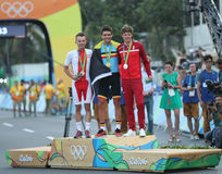 Rafal Majka POL L, Olympic champion Greg Van Avermaet BEL and Jakob Fuglsang DEN during men Cycling Road medal ceremony. RIO DE JANEIRO, BRAZIL - AUGUST 6, 2016 Royalty Free Stock Photos