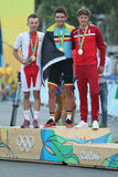 Rafal Majka POL L, Olympic champion Greg Van Avermaet BEL and Jakob Fuglsang DEN during men Cycling Road medal ceremony. RIO DE JANEIRO, BRAZIL - AUGUST 6, 2016 Royalty Free Stock Photo