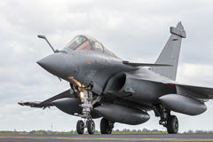 Rafale fighter jet. SCHLESWIG-JAGEL, GERMANY - JUN 23, 2014: French Air Force Dassault Rafale during the NATO Tiger Meet at Schleswig-Jagel airbase. The Tiger Royalty Free Stock Photo