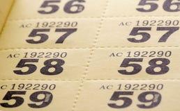 Raffle tickets. Yellow raffle tickets book in studio Royalty Free Stock Photos