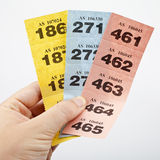 Raffle Tickets. Hand holding three strips of Raffle tickets Stock Photography