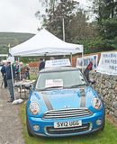 Raffle to win a car at Braemar Gathering. At the Braemar Royal Gathering this new luxury blue BMW Mini was being raffled at £1 per ticket, the funds being Royalty Free Stock Photo