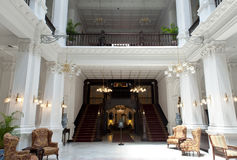The Raffles Hotel Singapore. Entrance and stairs to the private rooms of the famous hotel The Raffles in Singapore Stock Image