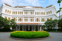 The Raffles Hotel in Singapore, main entrance. Singapore - September 08, 2012:  The Raffles Hotel. Opened in 1899, it was named after Singapore's founder Sir Stock Photography