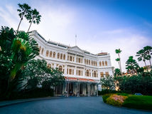 Raffles Hotel - Singapore. Raffles Hotel, Singapore - November 11, 2014: Front of the famous Raffles Hotel in Singapore City Royalty Free Stock Photography