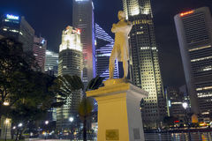 Raffles' Landing Site. Singapore - January 12,  2013: Statue of Sir Stamford Raffles in Singapore located on Raffles' Landing Site with modern buildings of Royalty Free Stock Photo