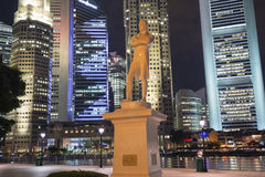 Raffles' Landing Site. SINGAPORE - NOVEMBER 13,  2014: Statue of Sir Stamford Raffles (a founder of the city) illuminated by night at Raffles' Landing Site with Stock Images