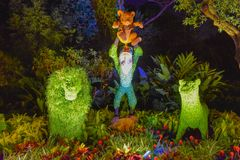 Rafiki monkey and Simba topiaries on forest scenery at Epcot in Walt Disney World  1 royalty free stock images