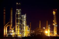 Rafinery. Oil refinery building at night Royalty Free Stock Photo