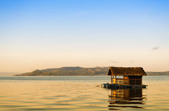 Raft. With nipa hut in Taal Lake during sunrise Stock Photography