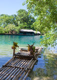Raft on the bank of the Blue lagoon, Jamaica. Landscape in a sunny day Royalty Free Stock Photography