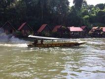 Raft and boat tour at Waterfall Sai Yok Kanchanaburi Thailand royalty free stock photography