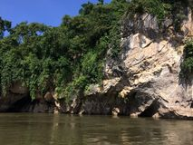 Raft and boat tour at Waterfall Sai Yok Kanchanaburi Thailand royalty free stock image