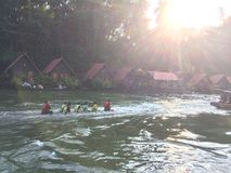 Raft and boat tour at Waterfall Sai Yok Kanchanaburi Thailand royalty free stock image