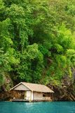 Raft house. Floating raft house with forest background Royalty Free Stock Image