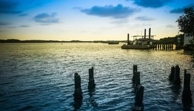 Raft house in evening at the seaside. Backgrounds royalty free stock images