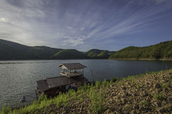 Raft house in the lake near mountain Stock Photography