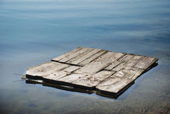 Raft moves through the water. Wooden raft moves through the water Royalty Free Stock Photography