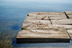Raft moves through the water. Wooden raft moves through the water Stock Photos