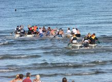 Raft race in the Irish sea ocean at Antrim Northern Ireland 2017 with foreground for editors text copy. Raft race in the Irish sea ocean at Co. Antrim Northern royalty free stock image