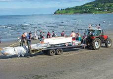 Raft race in the Irish sea ocean at Antrim Northern Ireland 2017 with foreground for editors text copy. Raft race in the Irish sea ocean at Co. Antrim Northern royalty free stock images