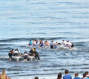Raft race in the Irish sea ocean at Antrim Northern Ireland 2017 with foreground for editors text copy. Raft race in the Irish sea ocean at Co. Antrim Northern royalty free stock photos
