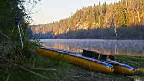 Raft on shore of mountain misty forest river Stock Photo