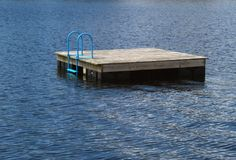 Raft on Silver Lake. A swimming raft in the middle of a lake stock images
