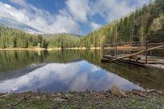 Raft and sky reflection on mountain lake Synevir Royalty Free Stock Photo