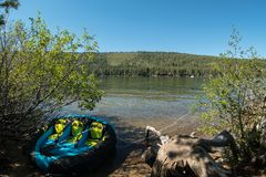 Raft tied up at the Donner Lake shoreline. Raft is tied at the shoreline at Donner Lake in the  northern Sierra Nevada range, California Royalty Free Stock Image
