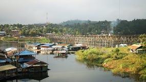 Raft village on the big lake near border of Thailand and Myanmar, with bamboo bridge floating made by villager, And high bridge. Raft village on the big lake Royalty Free Stock Photo