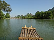 A raft on Yu Long river with Karst mountain Stock Photos