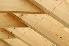Rafters. Wood rafters at a new home construction site, with the guiding level string Stock Photography