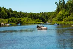 Rafters on the blue rafts float down the river /Wolf River , White Lake /,Wisconsin 7/8/2018 stock image