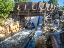 Rafters enjoying the Grizzly River Run, Disney California Adventure Park. ANAHEIM, CALIFORNIA - FEBRUARY 13: Rafters enjoying the Grizzly River Run rider at stock images