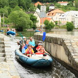 Rafters on river village Rozmberk Stock Image