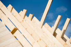 The rafters of the roof of the new wooden house Stock Photo