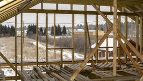 Rafters of wooden own housing under construction in suburbs. Rafters on second floor of wooden own housing under construction in the suburbs royalty free stock image