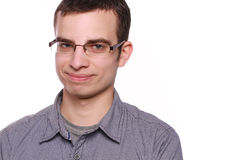 Сraftily smiling young man with glasses. On white background Royalty Free Stock Photography