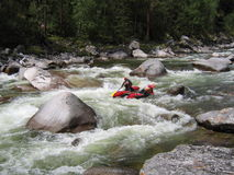 Rafting. Surmounting obstacle at Urik river, Sayany, Russia Stock Images