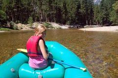 Rafting along river Stock Image