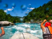 Rafting boat on the fast mountain river Stock Photos