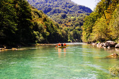 Rafting boat on the fast mountain river Tara Stock Images